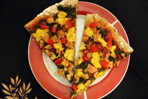 Pizza with spinach, red pepper, TVP, and vegan corn cheese